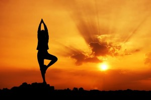 Image of yoga pose at sunset